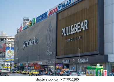 Unirea Shopping Center in Bucharest, Romania, East Europe - 9 July 2014- Facade of commercial building with many signboards of big brands like Stradivarius or Pull and Bear.