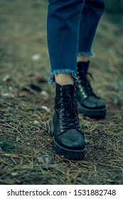 unisex black boots close-up photo in forest
