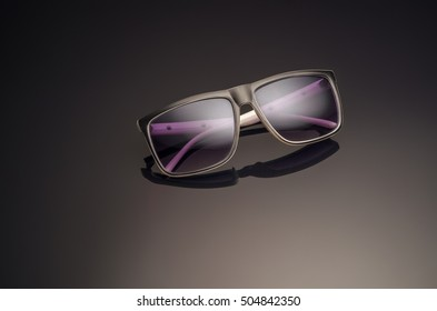 Unisex sunglasses on dark background. Mens sunglasses. Women sunglasses