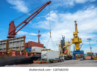 unit of container during loading from port yard to accommodate onto the bay of the ship, stevedore in charge of carry out fitting container shoe prior load on to vessel