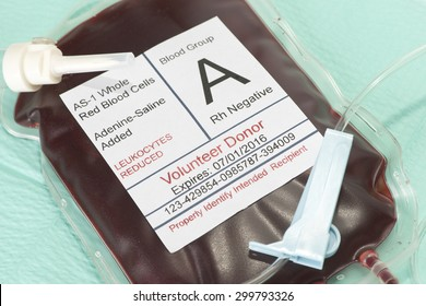 Unit of type A negative blood on sterile drape.  Label is fictitious and serial number is random.