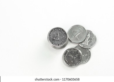 United Arab Emirates currency coins. 1 Dirhams stacked on top of each other. AED. DHS.