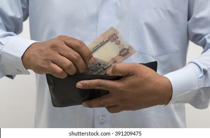 United Arab Emirates Dirhams in hand