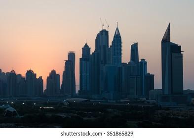 United Arab Emirates, Dubai, 07/14/2014, dubai marina dusty sunset cityscape silhouette  at sunset