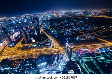 United Arab Emirates, Dubai, 07/14/2014, downtown dubai futuristic city neon lights and sheik zayed road shot from the worlds tallest tower burj khalifa