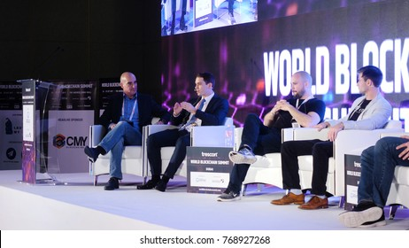 United Arab Emirates, Dubai - October 2017: Business Meeting and Conferences Ideas. Group of People Attending Conference and Listening to the Host Speakers On Stage. Conference in Dubai on blockchain