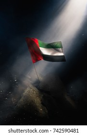 United Arab Emirates flag standing with triumph after a disaster.