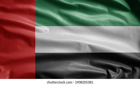 United Arab Emirates flag waving in the wind. Close up of UAE banner blowing, soft and smooth silk. Cloth fabric texture ensign background. Use it for national day and country occasions concept.