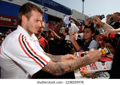 UNITED ARAB EMIRATES: JANUARY 02, 2008: David Beckham signs autograph to young AC Milan's fans, outside the Al Maktoom soccer stadium, in Dubai.