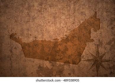 united arab emirates map on a old vintage crack paper background
