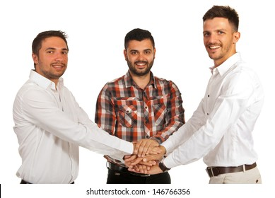 United casual business men with hands on top each other isolated on white background