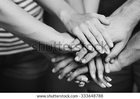 United hands close up.  Black and white retro stylization