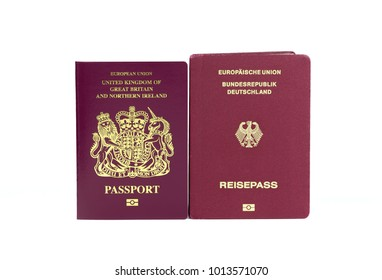 United Kingdom / British and German European Union biometric passports on a white background. Potential use as dual nationality / citizen concept.