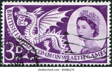 UNITED KINGDOM - CIRCA 1958: A stamp printed in England, is dedicated to 6th British Empire and Commonwealth Games, Cardiff, Welsh Dragon and shows Queen Elizabeth II, circa 1958