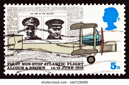 UNITED KINGDOM - CIRCA 1969: A stamp printed in United Kingdom shows page from Daily Mail, and Vickers FB-27 Vimy Aircraft, first non-stop Atlantic flight, Alcock and Brown,1919, circa 1969.