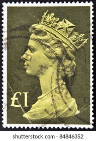 UNITED KINGDOM - CIRCA 1970: An English One Pound Used Postage Stamp showing Portrait of Queen Elizabeth 2nd, circa 1970