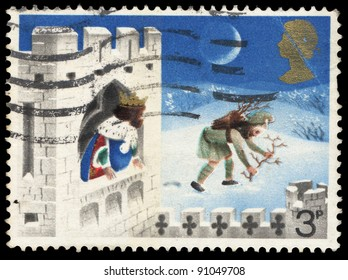 UNITED KINGDOM - CIRCA 1973: A stamp printed in United Kingdom shows illustration for fairy tale Good King Wenceslas, the Page and Peasant, circa 1973