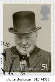 UNITED KINGDOM - CIRCA 1974: A stamp printed in United Kingdom shows Sir Winston Spencer Churchill (1874-1965), with bowler and cigar, 1940, politician, circa 1974