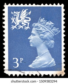 United Kingdom, Circa 1976:Postage stamp from the United Kingdom and Northern Ireland in the Regional - depicting Queen Elizabeth II 2 Wales series issued in 1976. Circa 1976