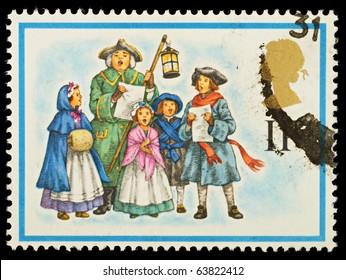 UNITED KINGDOM - CIRCA 1978: A British Used Christmas Postage Stamp showing Carol Singers, circa 1978