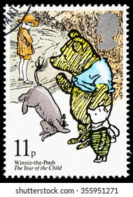UNITED KINGDOM - CIRCA 1979: A used postage stamp printed in Britain showing the Characters Winnie the Pooh, Eeyore and Piglet from Winnie the Pooh by AA Milne