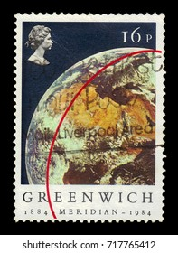 UNITED KINGDOM - CIRCA 1984: A stamp printed in UK shows portrait of Elizabeth II and Earth (View from Apollo 11), inscriptions Greenwich Meridian, series ?entenery of  Greenwich Meridian, circa 1984