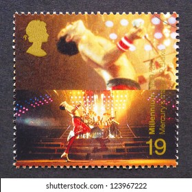 UNITED KINGDOM � CIRCA 1999: postage stamp printed in United Kingdom showing an image of Freddie Mercury from Queen band, circa 1999.