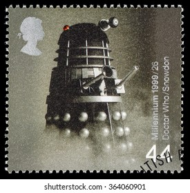 UNITED KINGDOM - CIRCA 1999: A used postage stamp printed in Britain celebrating Entertainers showing a Dalek from Dr Who