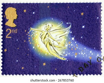 UNITED KINGDOM - CIRCA 2002: A stamp printed by GREAT BRITAIN shows Peter Pan flight. Peter Pan is a character created by Scottish novelist and playwright James Matthew Barrie, circa 2002.