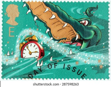 UNITED KINGDOM - CIRCA 2002: A stamp printed by GREAT BRITAIN shows Crocodile and Clock from Peter Pan stories by Scottish novelist and playwright James Matthew Barrie, circa 2002.
