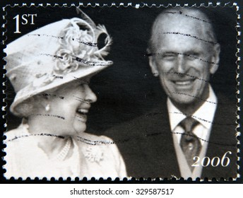 UNITED KINGDOM - CIRCA 2006: Stamp printed in UK shows Queen Elizabeth II and the Duke of Edinburgh Prince Philip leave St Pauls Cathedral, the Diamond Wedding Anniversary, circa 2006