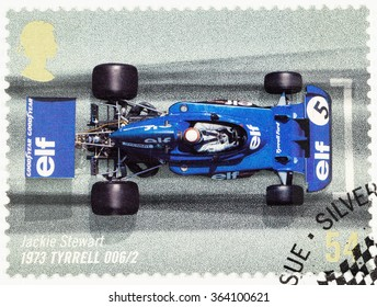 UNITED KINGDOM - CIRCA 2007: A used postage stamp printed in Britain celebrating the 50th Anniversary of the British Grand Prix showing Jackie Stewart in an 1973 Tyrrell