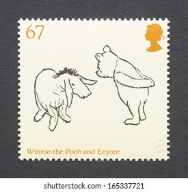 UNITED KINGDOM - CIRCA 2010: a postage stamp printed in United Kingdom showing an image of cartoon characters teddy bear Winnie-the-Pooh and the donkey Eeyore, circa 2010.