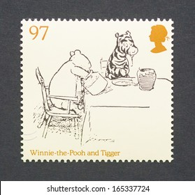 UNITED KINGDOM - CIRCA 2010: a postage stamp printed in United Kingdom showing an image of cartoon characters teddy bear Winnie-the- Pooh and the tiger Tigger, circa 2010.