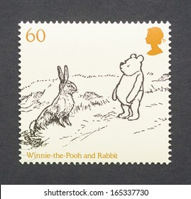 UNITED KINGDOM - CIRCA 2010: a postage stamp printed in United Kingdom showing an image of cartoon characters teddy bear Winnie-the- Pooh and the Rabbit, circa 2010.