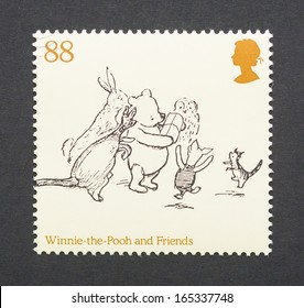 UNITED KINGDOM - CIRCA 2010: a postage stamp printed in United Kingdom showing an image of cartoon characters teddy bear Winnie-the- Pooh and some friends, circa 2010.