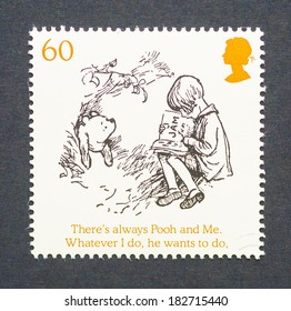 UNITED KINGDOM - CIRCA 2010: a postage stamp printed in United Kingdom showing an image of cartoon characters teddy bear Winnie-the- Pooh and the boy Christopher Robin, circa 2010.