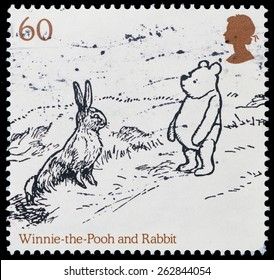 UNITED KINGDOM - CIRCA 2010: a postage stamp printed in United Kingdom showing an image of cartoon characters teddy bear Winnie Pooh and the Rabbit, circa 2010.