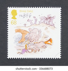 UNITED KINGDOM - CIRCA 2012: a postage stamp printed in United Kingdom showing an image of Roald Dahl book BFG and Sophie wake the Giants, circa 2012.