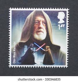 UNITED KINGDOM - CIRCA 2015: a postage stamp printed in United Kingdom commemorative of Star Wars movie with Obi-Wan Kenobi character, circa 2015.