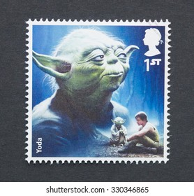UNITED KINGDOM - CIRCA 2015: a postage stamp printed in United Kingdom commemorative of Star Wars movie with Yoda character, circa 2015.