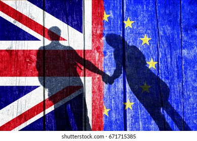 United Kingdom and European Union textured flags background with grunge shadow of couple holding hands. Conceptual and symbolic illustration of the friendly situation between Uk and EU.