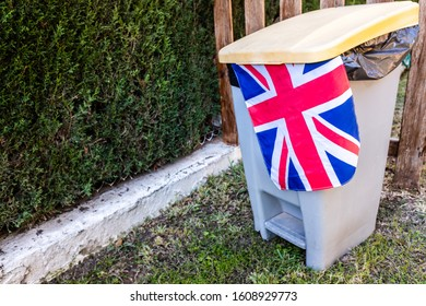 United Kingdom flag thrown in the trash by European citizens.