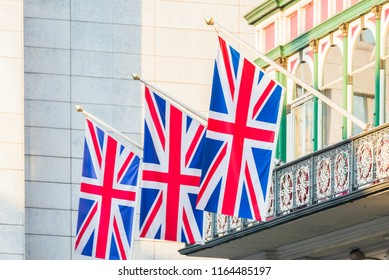 United Kingdom flags hanging from a balcony. Great Britain national symbol.