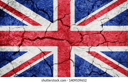United Kingdom of Great Britain and Northern Ireland flag on dry earth ground texture background