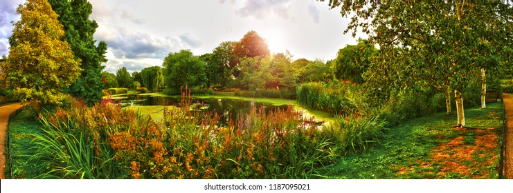 The United Kingdom, London, Japanese Garden. August 23rd, 2018. Panorama view at pond, flowers and trees inside the Japanese Garden in summer sunny day.