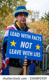United Kingdom, London, Westminster, 28 October 2019: Male Brexit Protestor outside the Houses of Parliament in London- protesting against the UK leaving the EU (European Union).