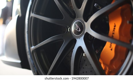 United Kingdom, Manchester March 2021. The McLaren Logo The Wheel Of The Car On A 2016 McLaren 675LT Spyder In Chicane Grey