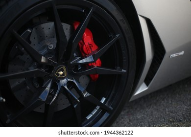 United Kingdom, Manchester March 2021.The Rear Gloss Black Wheel On A 2014 Grey Lamborghini Aventador With Red Brake Callipers