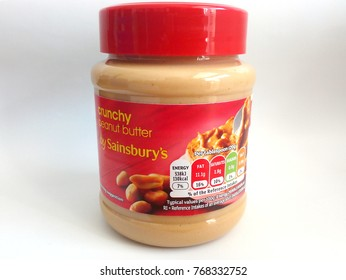 UNITED KINGDOM - OCTOBER, 2017: Label and nutritional values per tablespoon of a Crunchy Peanut Butter jar by Sainsbury's, the second largest chain of supermarkets in the UK.